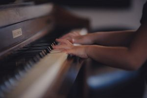 A girl playing piano by herself