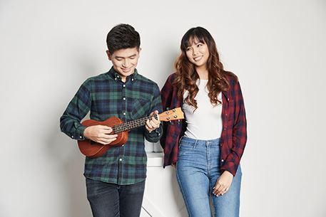 couple playing ukulele