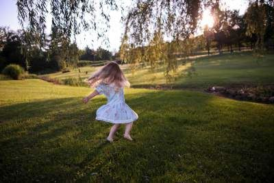 Girl playing on the grass