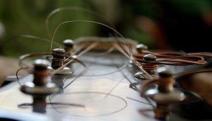 messy guitar strings