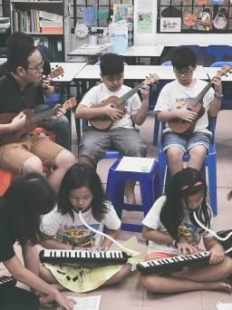 Music school singapore with students and family